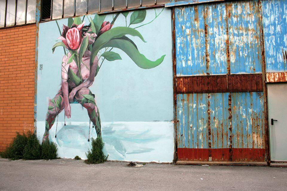 """Il murales di Francisco Bosoletti sulla porta del Cantiere navale, """"Vedo A Colori"""" 2015"""